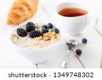 musli with wild berries and... | Shutterstock . vector #1349748302