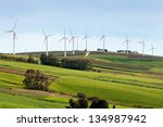 Wind Turbines On Hilly Expanse