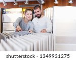 smiling young couple looking... | Shutterstock . vector #1349931275