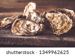 raw oysters on the board close... | Shutterstock . vector #1349962625
