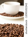 a white cup with many coffee...   Shutterstock . vector #1350102242