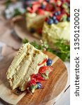 slice of a pistachio leyer cake ... | Shutterstock . vector #1350120002