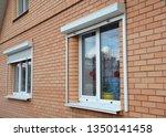 rolling shutters house windows... | Shutterstock . vector #1350141458