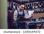 young male metallurgy worker... | Shutterstock . vector #1350149372