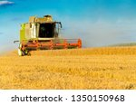 Combine Harvesting In A Field...