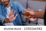 asian man in blue jean jacket... | Shutterstock . vector #1350266582