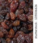 raisins isolated on white...   Shutterstock . vector #135036626