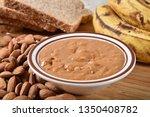 a dish of fresh almond butter... | Shutterstock . vector #1350408782
