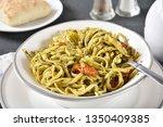 fresh linguine with basil pesto ... | Shutterstock . vector #1350409385