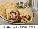 gourmet chicken wrap sandwich... | Shutterstock . vector #1350411995