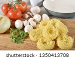 angel hair pasta nests with... | Shutterstock . vector #1350413708