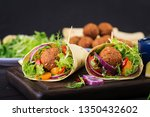 tortilla wrap with falafel and... | Shutterstock . vector #1350432602