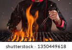 closeup of chef holding fork... | Shutterstock . vector #1350449618