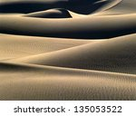 Sand dunes at sunrise in Death Valley, California - stock photo