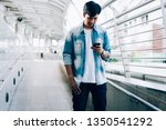 man holding a smartphone. using ... | Shutterstock . vector #1350541292