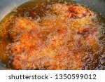 boiling oil in frying pan for... | Shutterstock . vector #1350599012