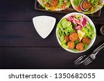 falafel and fresh vegetables.... | Shutterstock . vector #1350682055