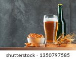 lager beer and snacks on stone...   Shutterstock . vector #1350797585