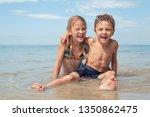 two happy little children... | Shutterstock . vector #1350862475