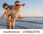 father and son playing on the... | Shutterstock . vector #1350862478