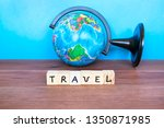 word travel and globe on the... | Shutterstock . vector #1350871985