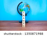 word travel and globe on the... | Shutterstock . vector #1350871988