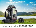hiking backpack and boots... | Shutterstock . vector #1350872285