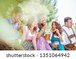 five friends having fun on... | Shutterstock . vector #1351064942