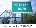 Mississippi River sign in front of a truss bridge