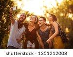 group of friends taking selfie... | Shutterstock . vector #1351212008