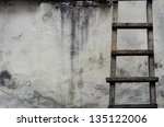 Old Ladders On Rustic Dirty Wall