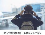 a boy in headphones with a... | Shutterstock . vector #1351247492