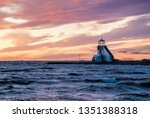 Beacon or lighthouse by the sea at sunset. Location is Nallikari Oulu Finland.