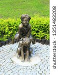 Small photo of Kharkiv / Ukraine. 07 August 2016: Bronze sculpture of children playing leapfrog in summer park. Boy and girl playing leapfrog in park. Sculpture children make leapfrog in city park of Kharkiv