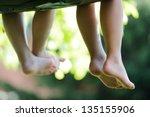 Happy Children Sitting On Gree...