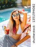 beautiful woman with long hair... | Shutterstock . vector #1351594082