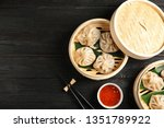 bamboo steamers with tasty... | Shutterstock . vector #1351789922
