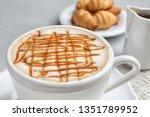 cup of tasty caramel macchiato... | Shutterstock . vector #1351789952