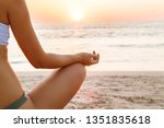 woman practicing yoga by the...   Shutterstock . vector #1351835618
