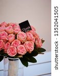 pink rose bouquet with message  | Shutterstock . vector #1352041505