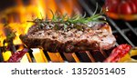 Beef Steak On Grill With...
