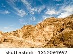 high rocky mountains in the... | Shutterstock . vector #1352064962