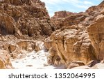 high rocky mountains in the... | Shutterstock . vector #1352064995