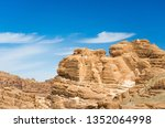 high rocky mountains in the... | Shutterstock . vector #1352064998