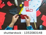 designer working with paper... | Shutterstock . vector #1352083148