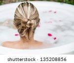 Woman Taking A Bubble Bath  ...