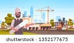 man architect in helmet holding ... | Shutterstock .eps vector #1352177675