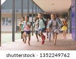 front view of happy school kids ... | Shutterstock . vector #1352249762