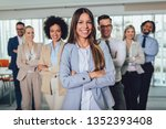 Small photo of Group of happy business people and company staff in modern office, representig company.Selective focus.