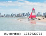 carrying a sailing boat on a...
